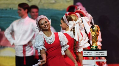 Performers dance during the World Cup draw