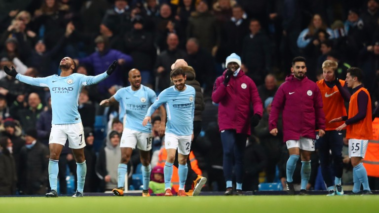 Raheem Sterling (left) celebrates his late winner against Southampton
