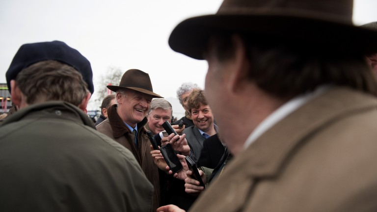 Nicky Henderson goes to congratulate winning trainer Willie Mullins