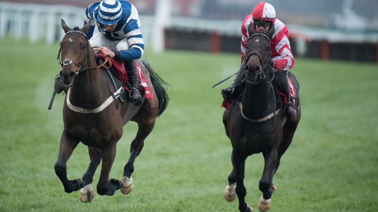 Total Recall and Paul Townend (right) battle it out with Whisper in a thriller for the Ladbrokes Trophy at Newbury