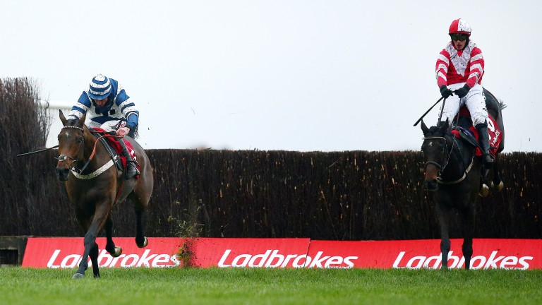 Total Recall (right) and Whisper jump the last in the Ladbrokes Trophy at Newbury
