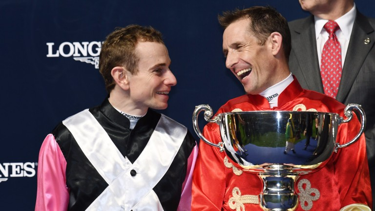 HONG KONG - DECEMBER 07:  Hugh Bowman of Australia poses with the winning trophy and smiles at runner up Ryan Moore of the U.K during Longines International  Jockeys' Championship at Happy Valley Racecourse on December 7, 2016 in Hong Kong, Hong Kong.  (P