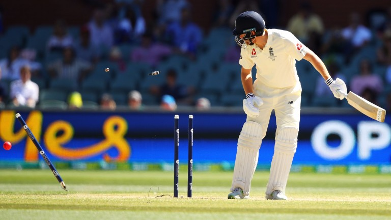 Jonny Bairstow is bowled by Mitchell Starc, sealing England's 120-run defeat in Adelaide