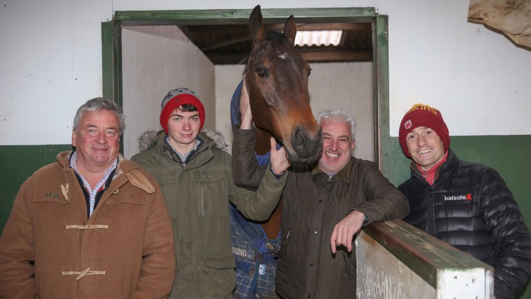 Splash Of Ginge with Nigel Twiston-Davies and sons Sam (right) and Willy (second left) and owner John Neild