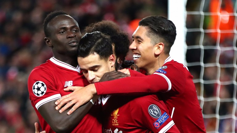 Philippe Coutinho celebrates with Liverpool mates Mohamed Salah, Roberto Firmino and Sadio Mane