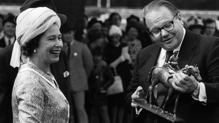 The Queen, pictured here with Nelson Bunker Hunt in 1974, presented the King George trophy