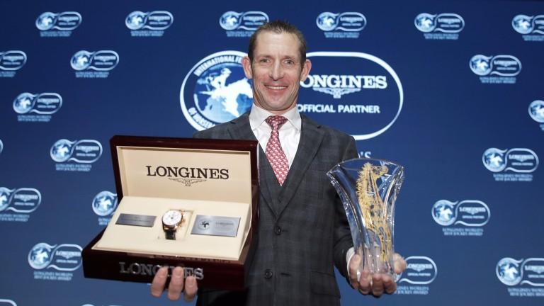 Hugh Bowman collects his Longines World's Best Jockey Award