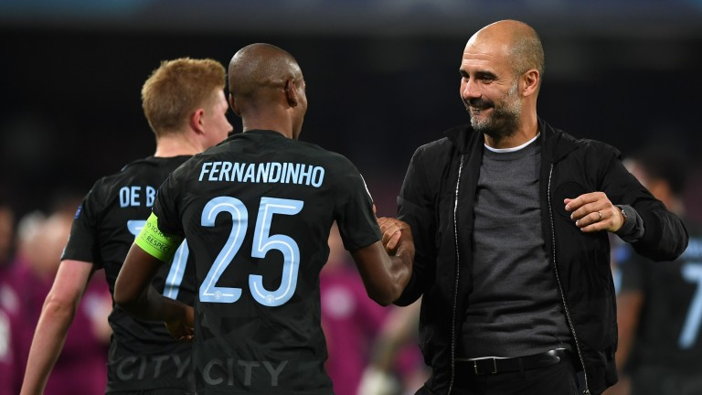 Pep Guardiola (right) should be pleased with Manchester City's Champions League draw