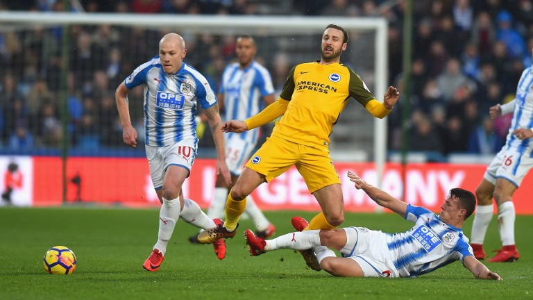 Jonathan Hogg (ground) and Aaron Mooy (left) are key for Huddersfield