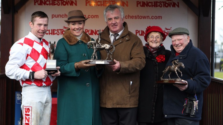 Owner Peter Curran receives the trophy after Flemenstar's victory in the 2012 John Durkan Chase at Punchestown
