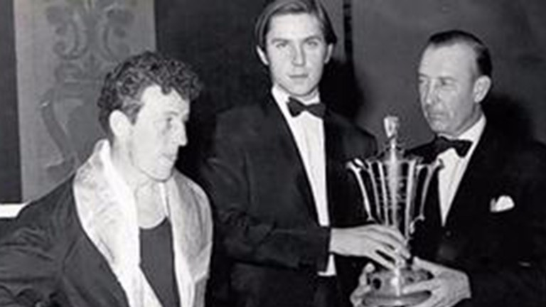 Nash is presented with a trophy at the National Stable Lads Boxing Championships