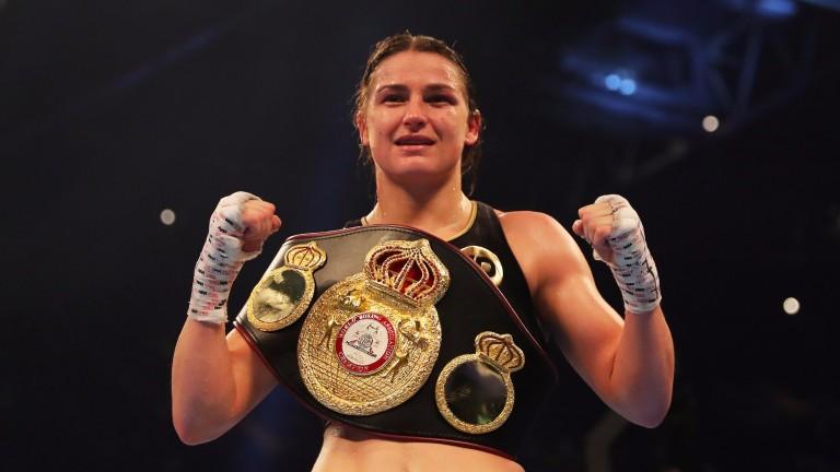 Katie Taylor celebrates winning the WBA lightweight title