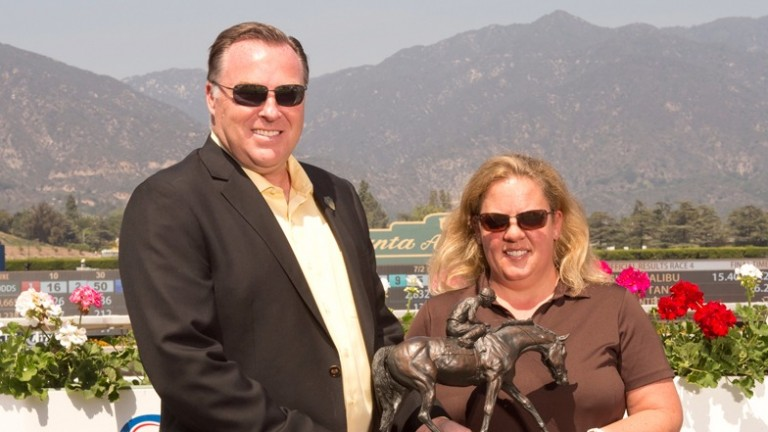 Tom Ludt presents the leading owner award for the 2013-14 winter meet at Santa Anita to Aimee Dollase