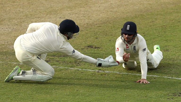 Jonny Bairstow (left) and Mark Stoneman fail to snap up a chance offered by Shaun Marsh