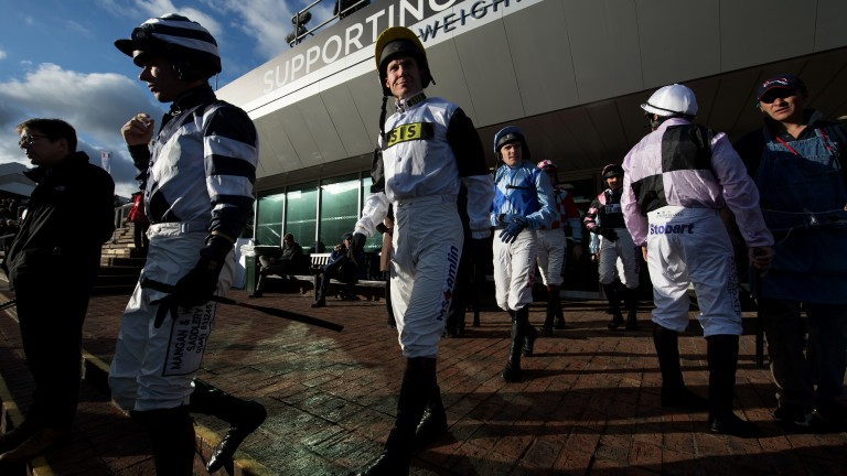 Ready to ride: the jockeys make their way to the parade ring