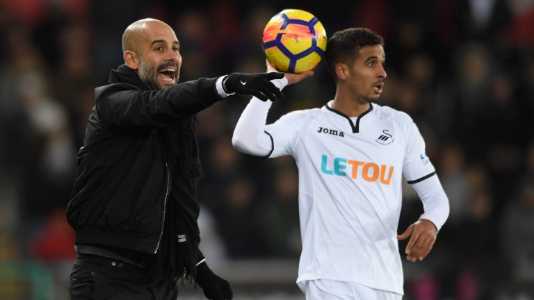 Pep Guardiola's Manchester City side claimed a 15th straight win at Swansea