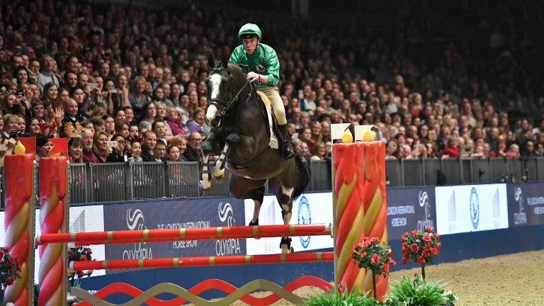 Frankie Dettori takes the final jump on his way to a clear round