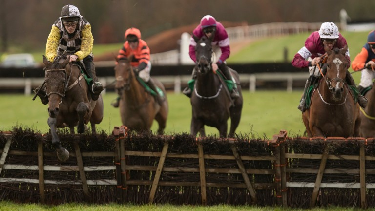Next Destination (left) and David Mullins take the last on the way to victory in the Navan Novice Hurdle