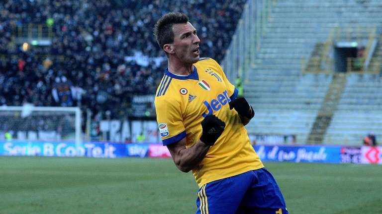 Mario Mandzukic celebrates his goal for Juventus at Bologna