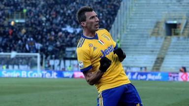Mario Mandzukic celebrates his goal for Juventus at Bologna
