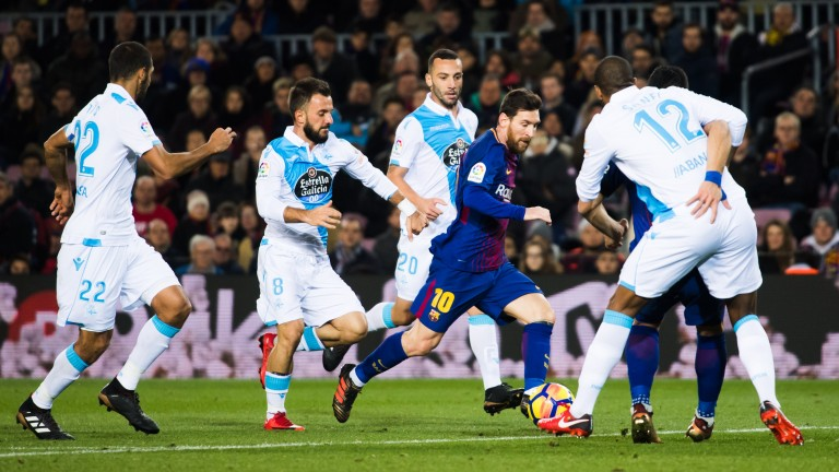 Barcelona's Leo Messi torments the Deportivo defence