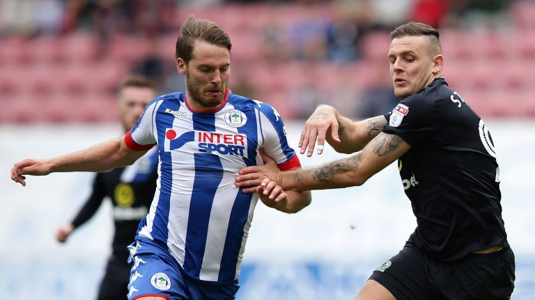 Nick Powell (left) is crucial to Wigan's chances