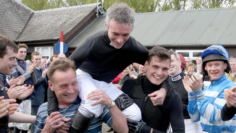 Ryan Day (right) helps to carry his mentor Brian Harding on the veteran jockey's retirement in April