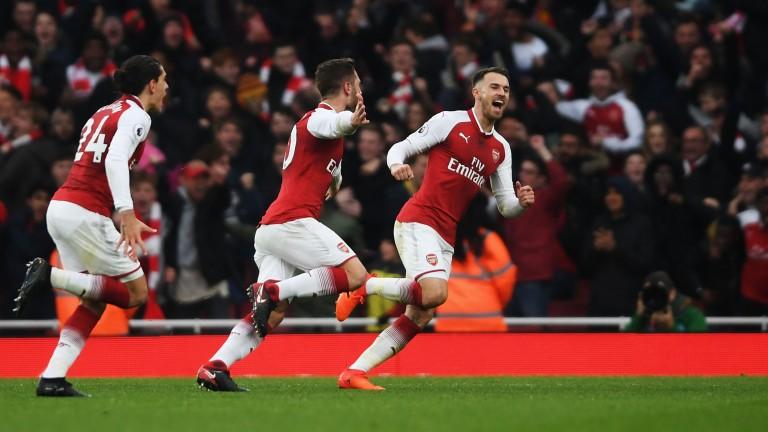 Shkodran Mustafi of Arsenal celebrates with team mates