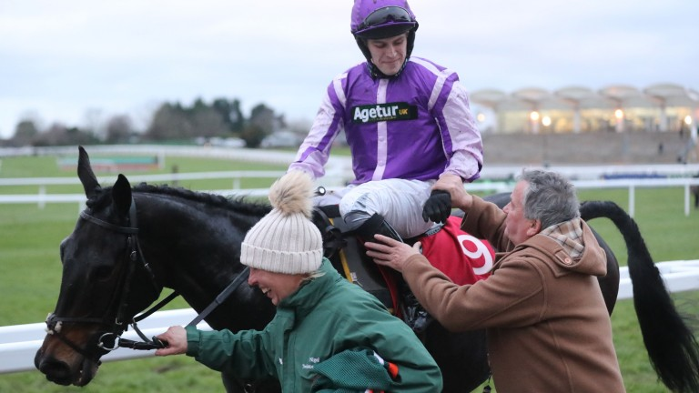 Tom Humphries is congratulated by Nige after his win on Arthur's Gift at Cheltenham
