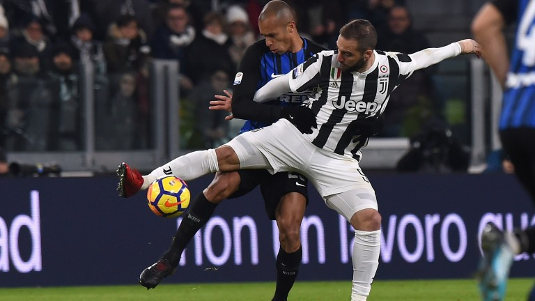 Joao Miranda and Gonzalo Higuain battle for the ball when Juventus played Inter