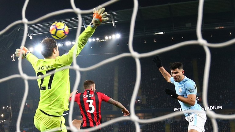 Sergio Aguero of Manchester City scores his sides third goal past Asmir Begovic of Bournemouth