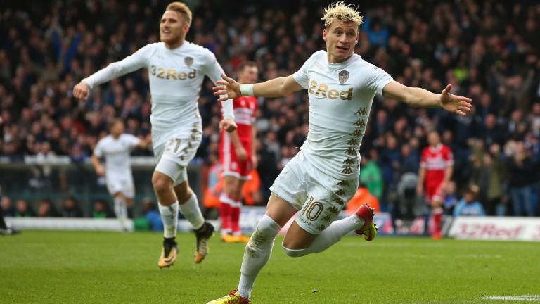 Leeds winger Ezgjan Alioski wheels away in celebebration
