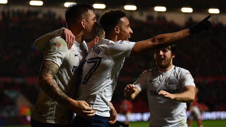 Callum Robinson of Preston celebrates with teammates