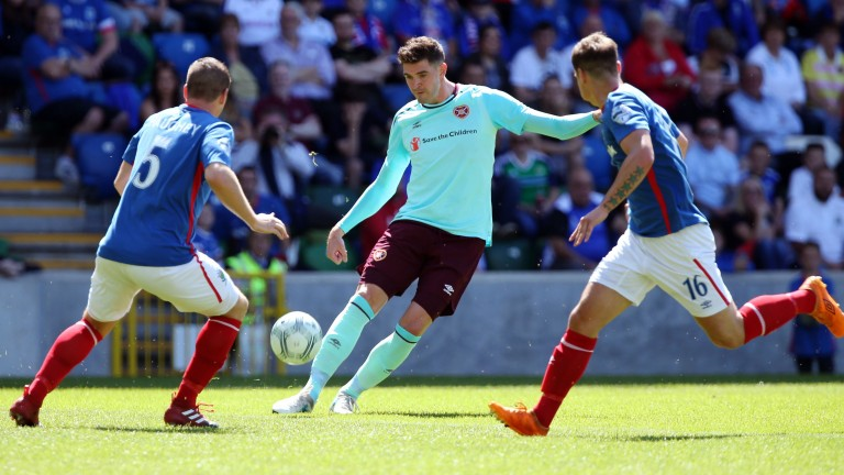 Kyle Lafferty (centre) is a key goal threat for Hearts