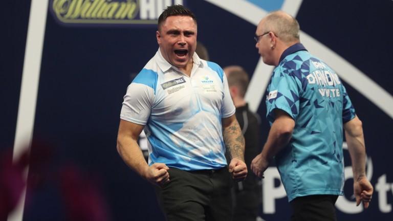 Gerwyn Price reacts during his match against Ian White