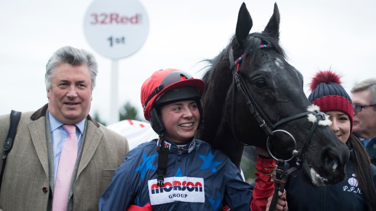 What a team! Bryony Frost gives Black Corton an admiring glance after the pair's Grade 1 victory at Kempton