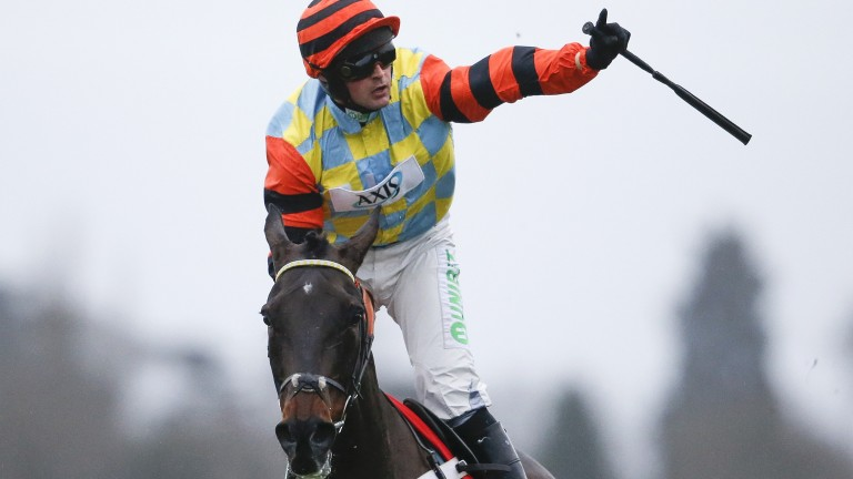 Jockey Nico de Boinville salutes the crowd after his King George VI Chase triumph on Might Bite