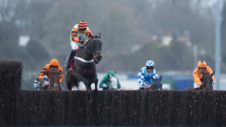 Might Bite soars over the final fence on the way to winning the King George VI Chase under Nico de Boinville