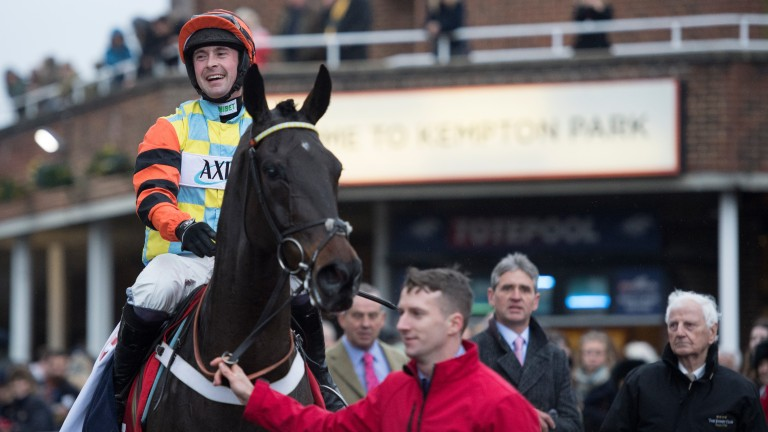 All smiles: Nico de Boinville savours every second of his King George VI Chase victory on Might Bite