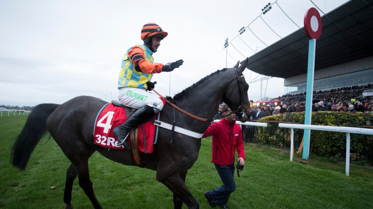 Might Bite parades in front of the stands after winning the King George VI Chase at Kempton on Tuesday