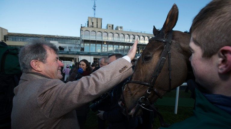 JP's flying: a delighted JP McManus gives Anibale Fly a pat following his big-race victory in the Paddy Power Chase
