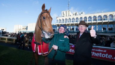 Simply smashing: owner David Robinson gives the thumbs-up after the stewards reverse the result in the Paddy's Rewards Club Chase in favour of his Simply Ned