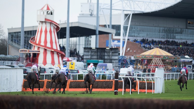 Helter-skelter racing: all the fun of the fair in the background as the action heats up in the mares' handicap hurdle