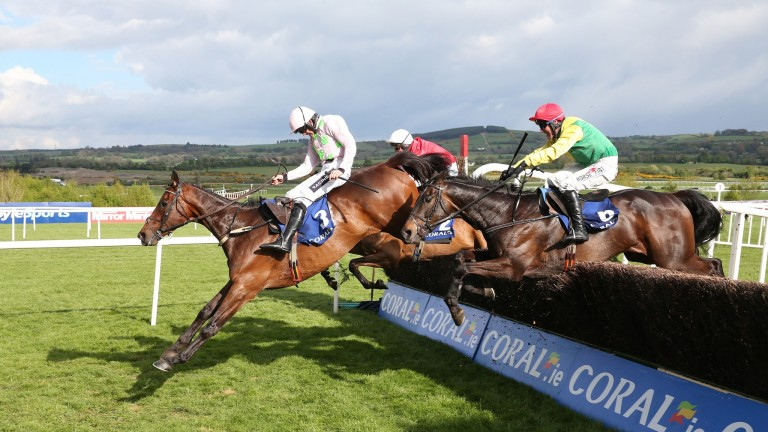 Djakadam leads Sizing John over the last in the Punchestown Gold Cup