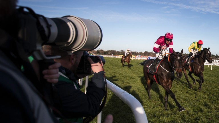 Snapping away: camera lenses are poised to catch the moment Apple's Jade passes the winning post in front in the 3m Squared Financial Christmas Hurdle under Davy Russell