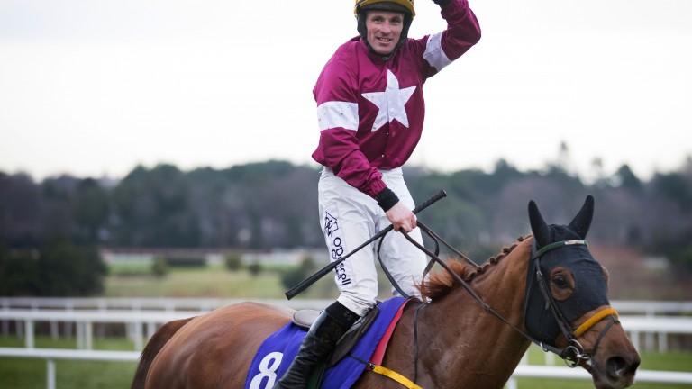 Celebratory wave: Sean Flanagan enjoys Grade 1 success aboard the Noel Meade-trained Road To Respect
