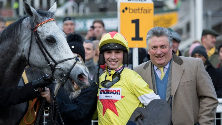Harry Cobden and Paul Nicholls celebrate their Tingle Creek victory with Politologue