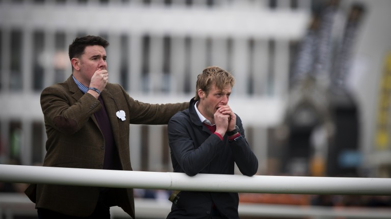 Nail biter: two punters are in a nervous state as they watch the action unfold in the Foxhunter on the final day of the Cheltenham Festival