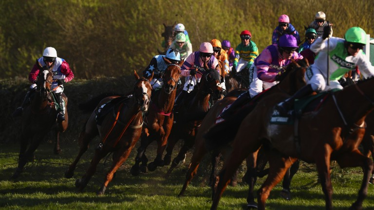 Creeping into it: One For Arthur and Derek Fox take the Canal Turn with still plenty of horses in front of them on their route to victory in the Grand National