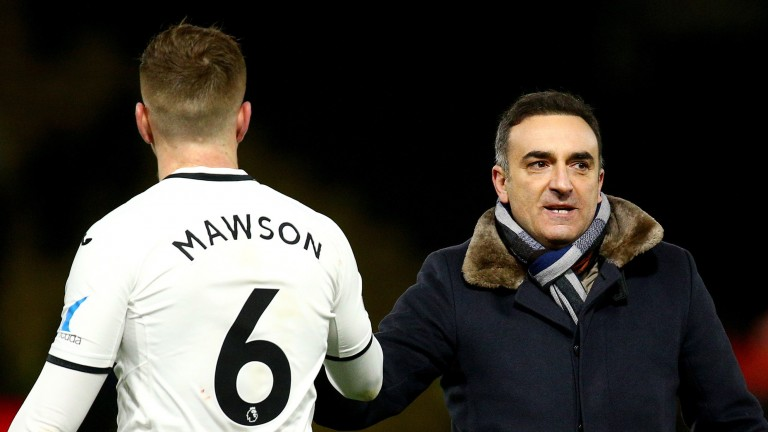 Swansea Manager Carlos Carvalhal celebrates his team's win with Alfie Mawson